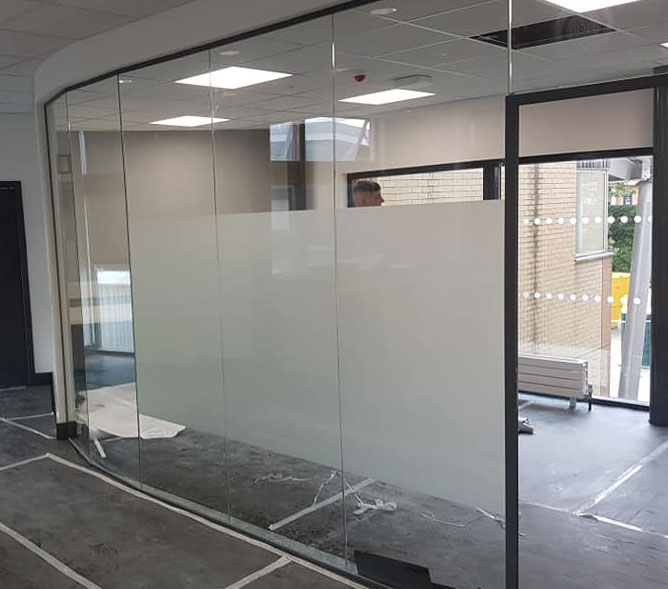Privacy band to partitions and 50mm x 50mm manifestation to all exterior glazing and grey vinyl to hide partition wall Prospect Building Sunderland University