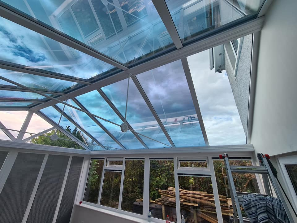 1. Silver 20 Low E solarfilm installed to all roof glazing reducing heat, glare, uv and retains heat during winter months in Cumbria